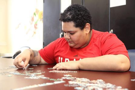 man doing a puzzle