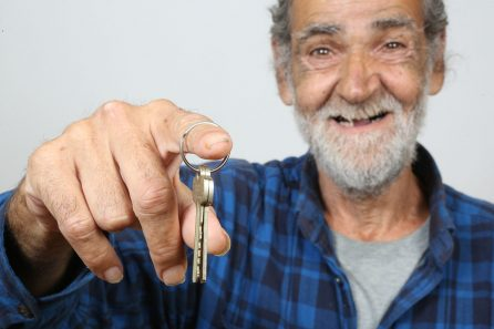 Happy man holding house keys