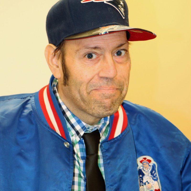 Happy man in new england patriots apparel