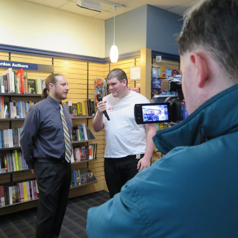 Men conducting interview in a library